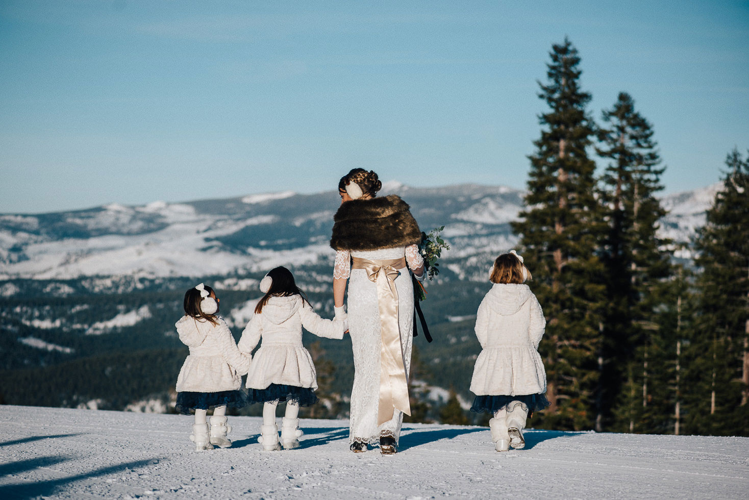 bride and bridesmaids winter wedding Northstar California