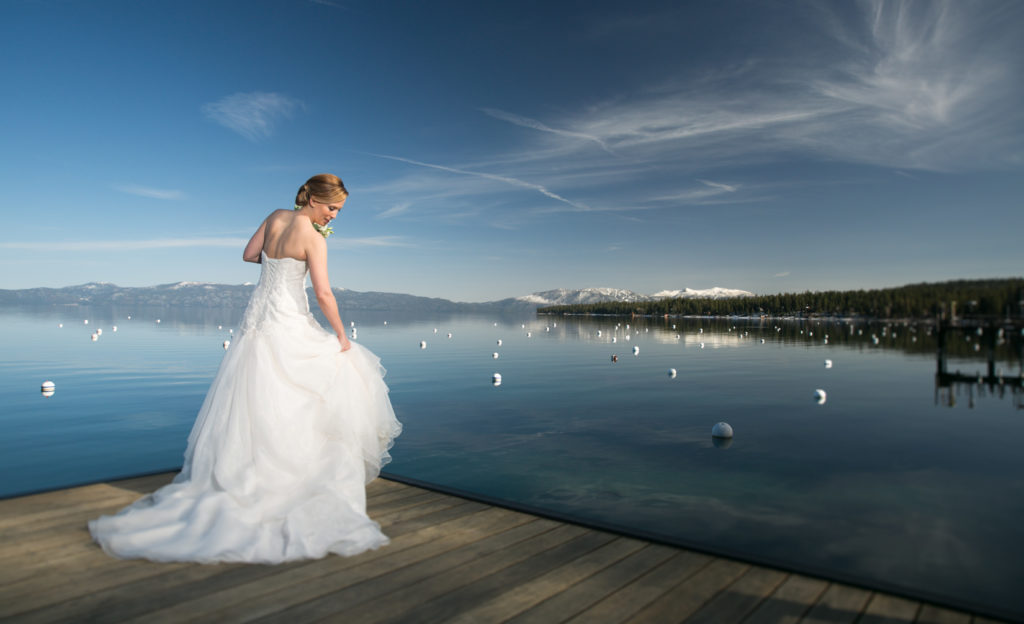 Bride on Pier Lake Tahoe wedding