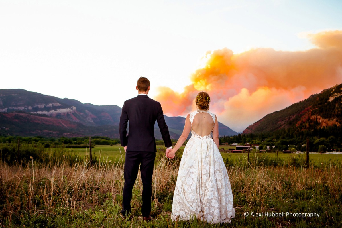 couple watching fire near wedding