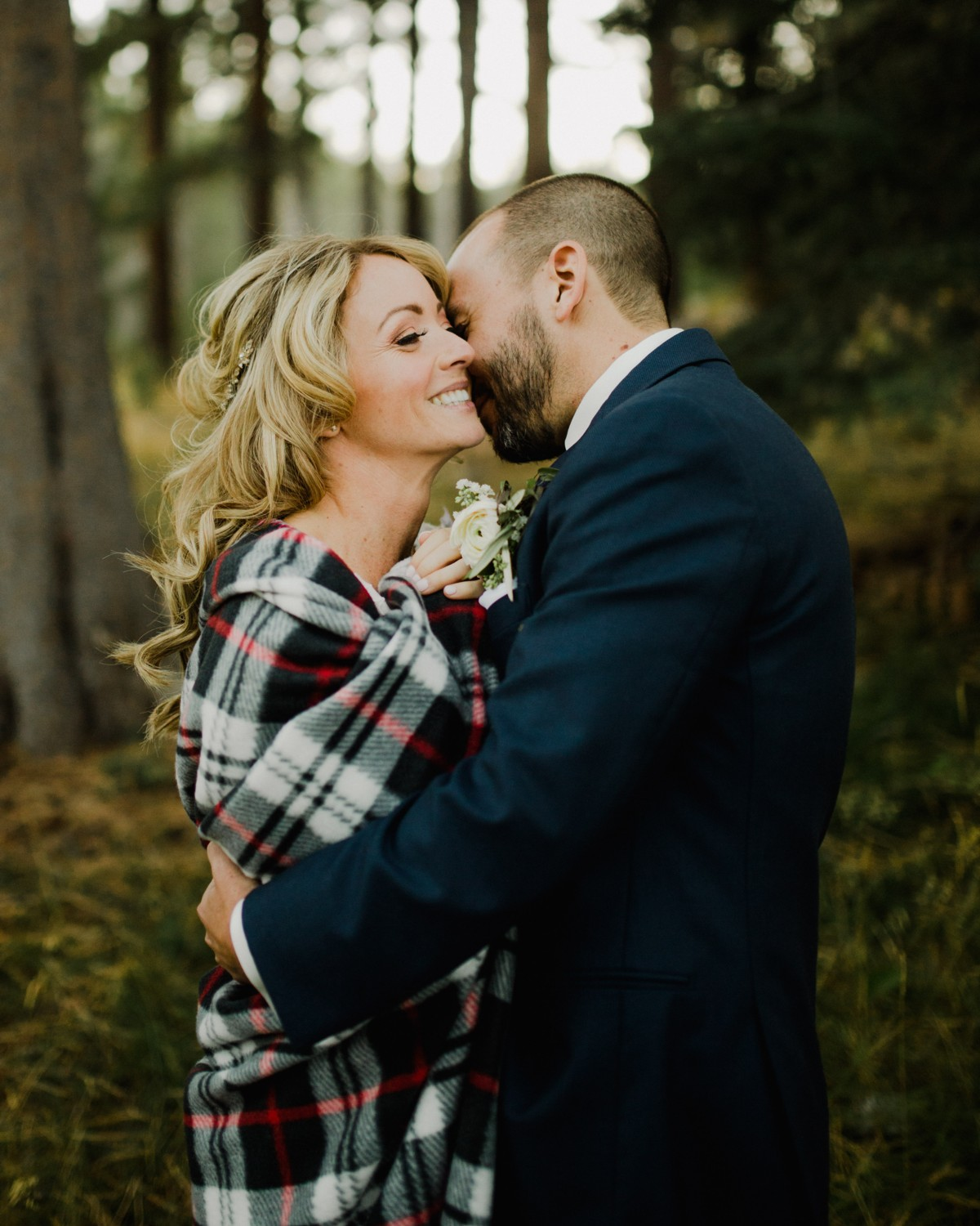 Bride smiling with groom after hair and makeup by Love Is In The Hair Lake Tahoe wedding Underwood Photography