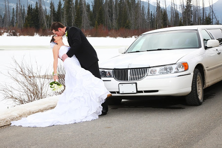 Wedding Couple by Limousine