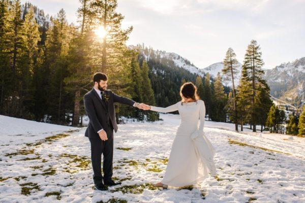 Couple walking in snow - winter wedding Lake Tahoe