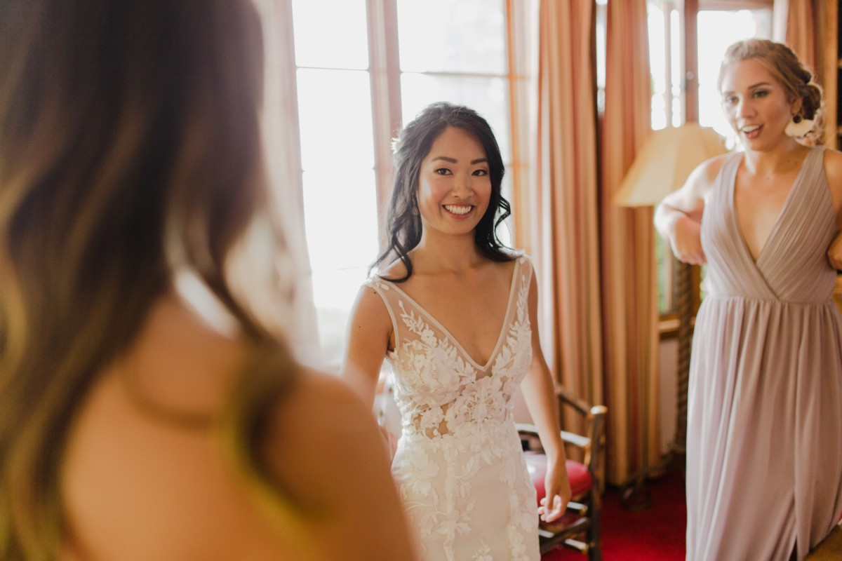 Bride getting ready with bridesmaids after hair and makeup