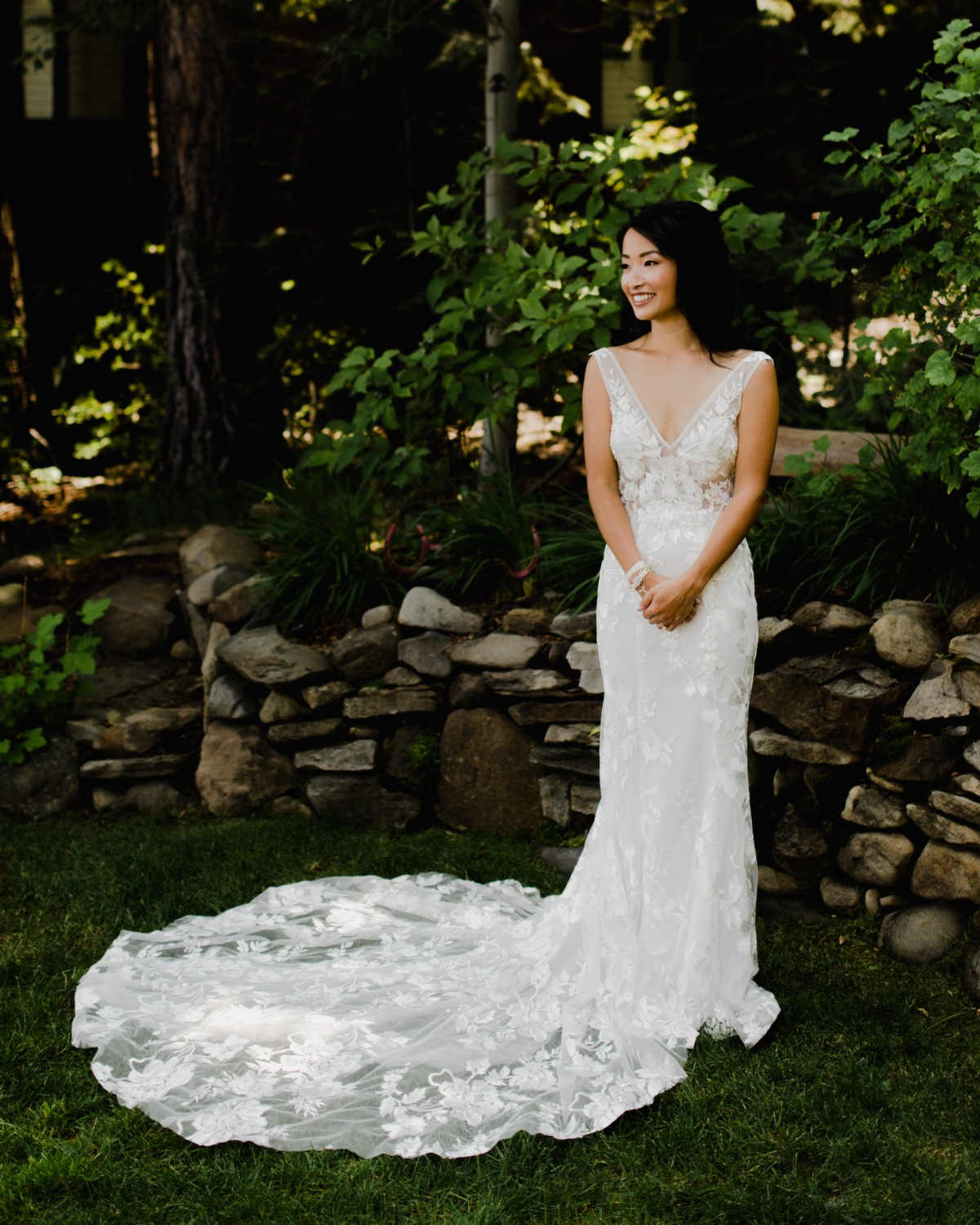 Bride posing for photos after hair and makeup by Love Is In The Hair Lake Tahoe wedding