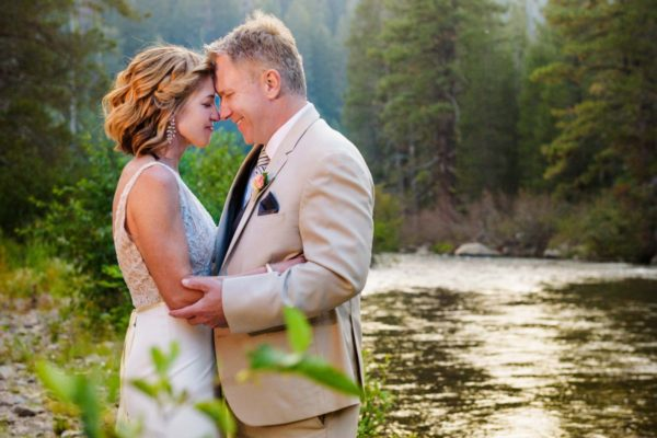 Lake Tahoe wedding couple by the Truckee River