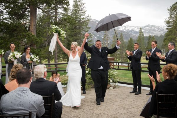 Resort at Squaw Creek Wedding Lake Tahoe - couple celebrating in rain
