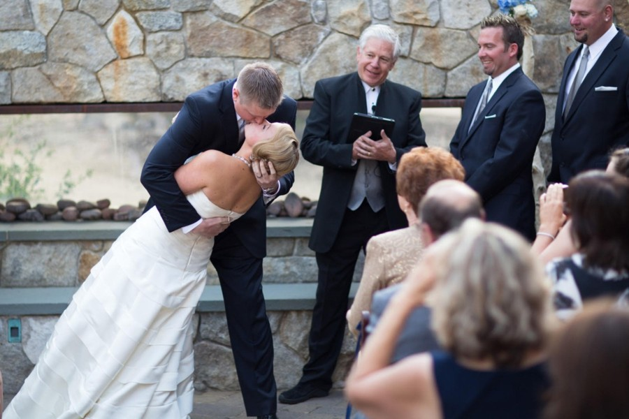 couple kissing at wedding ceremony conducted by Reverend Mark Frady Lake Tahoe wedding officiant