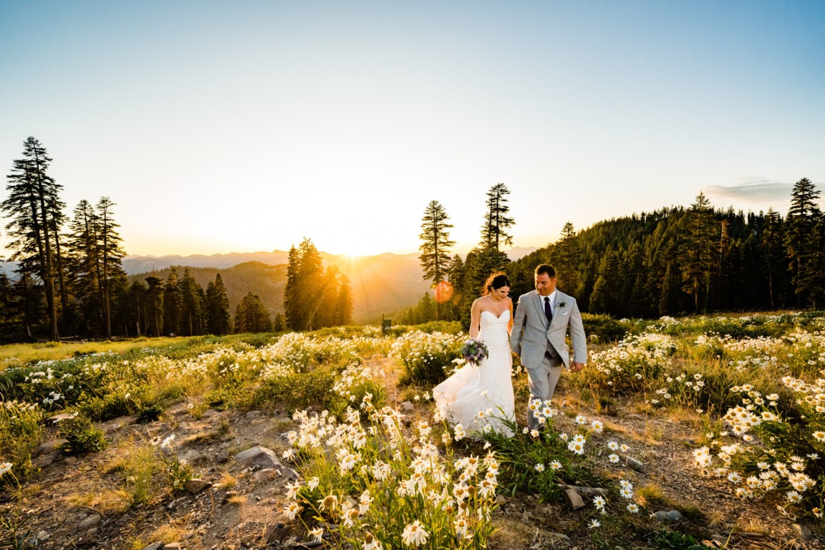 wedding couple walking at sunset in mountains at Northstar California
