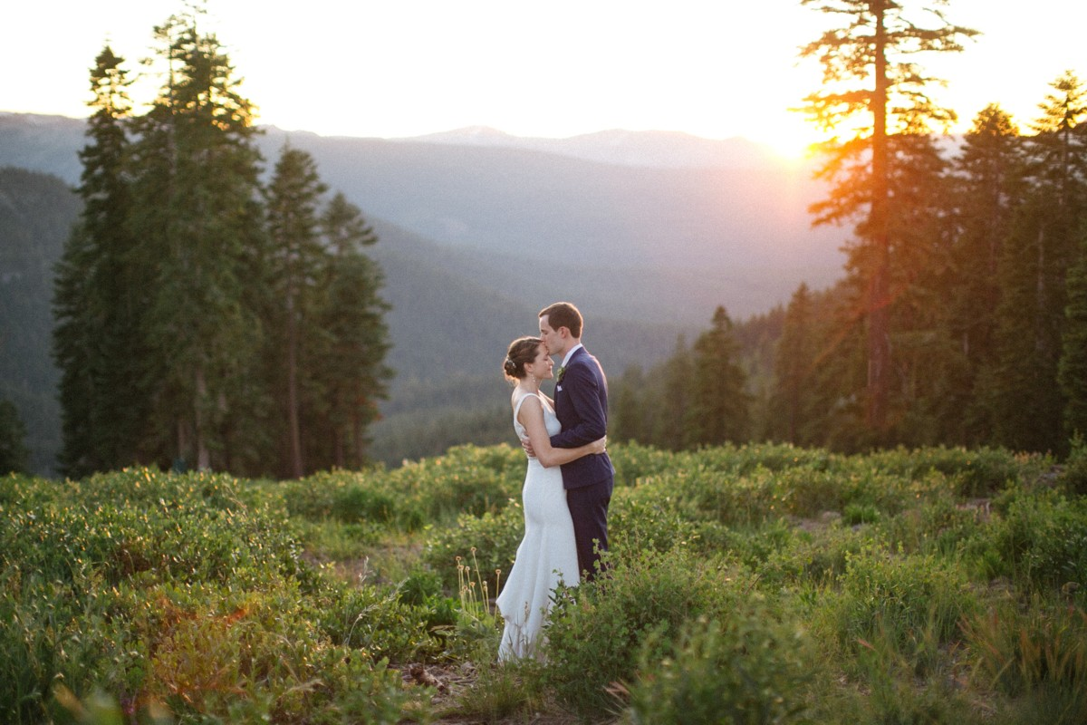 wedding couple at sunset on mountaintop at Northstar near Lake Tahoe