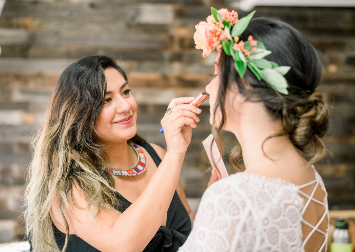 Nancy Rice Artistry - applying makeup for Lake Tahoe wedding