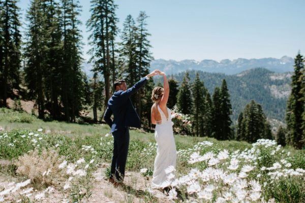 wedding couple dancing on mountaintop Northstar California near Lake Tahoe
