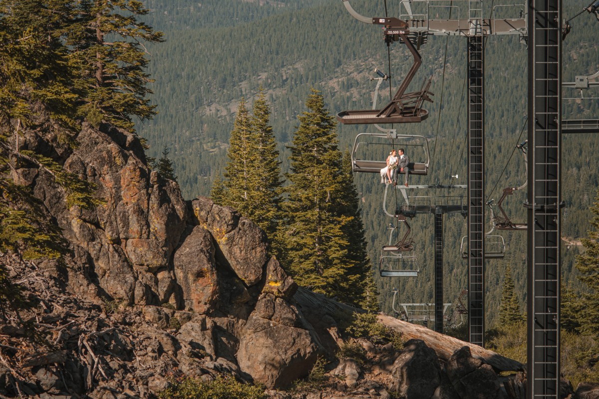 wedding couple riding chairlift at Northstar California