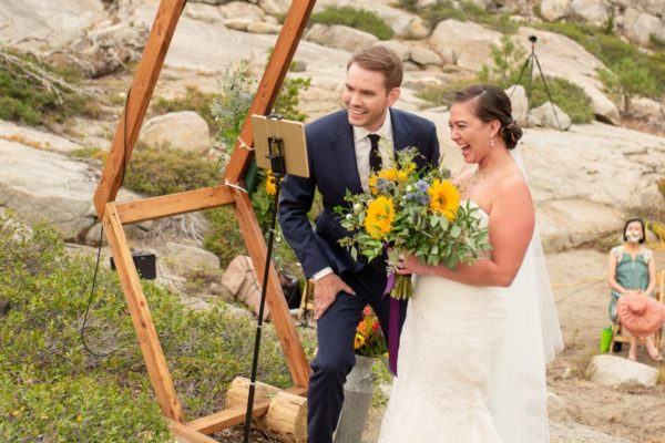 couple celebrating wedding safely with virtual officiant at The HideOut near Lake Tahoe
