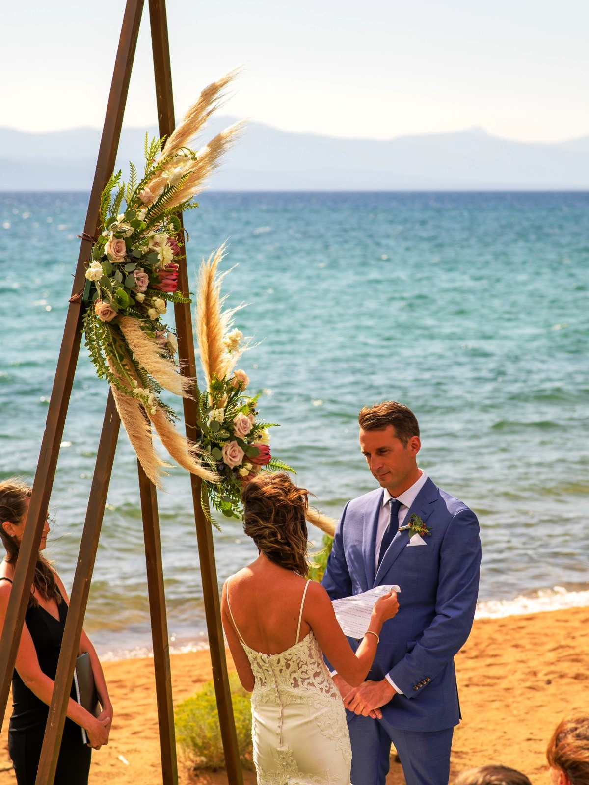 lakeside wedding ceremony at Edgewood Tahoe - bride reads vows