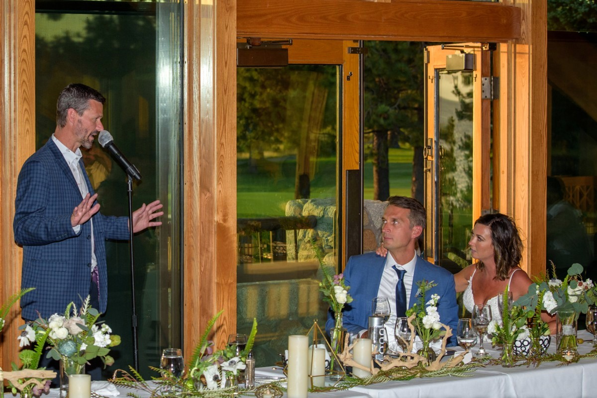 toasting couple from safe distance at Lake Tahoe wedding