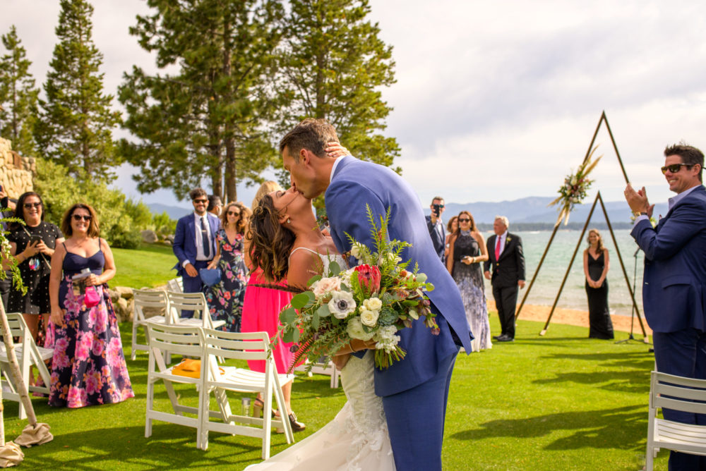 Edgewood Tahoe safe wedding - couple kissing after ceremony