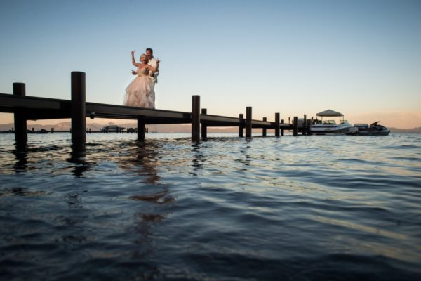Lake Tahoe best real weddings - couple celebrating on pier